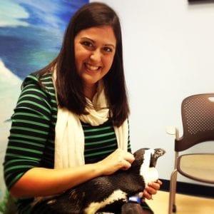 holding a penguin at the aquarium | New Orleans Moms Blog