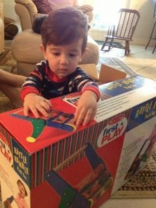 kid playing with a box