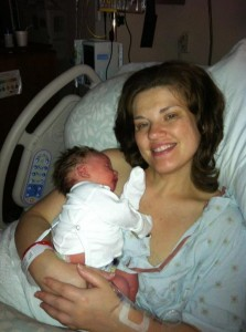 Holding Nathaniel 3 hours after birth. He had nursed for the first time.