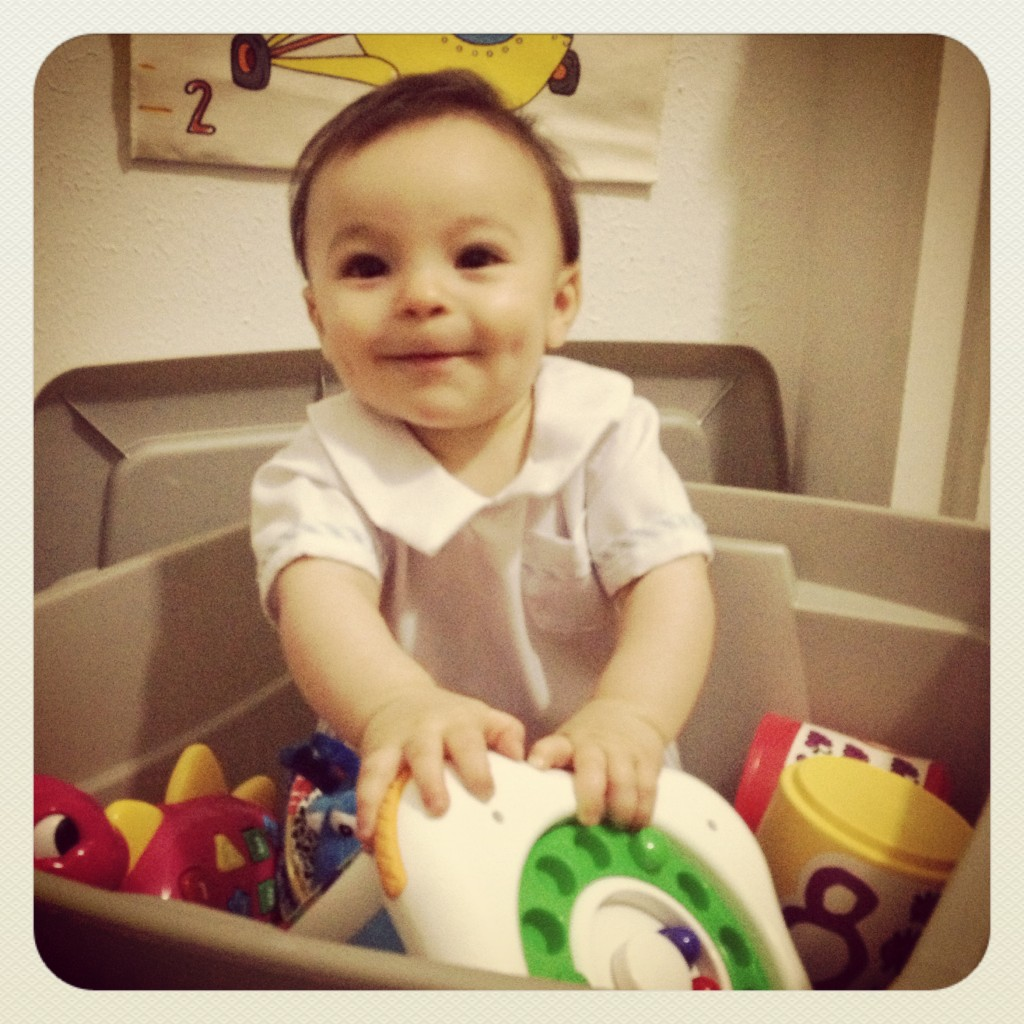 Tomás playing in our temporary toy box
