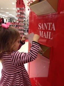 Annelise mailing her Santa letter at Macy's.