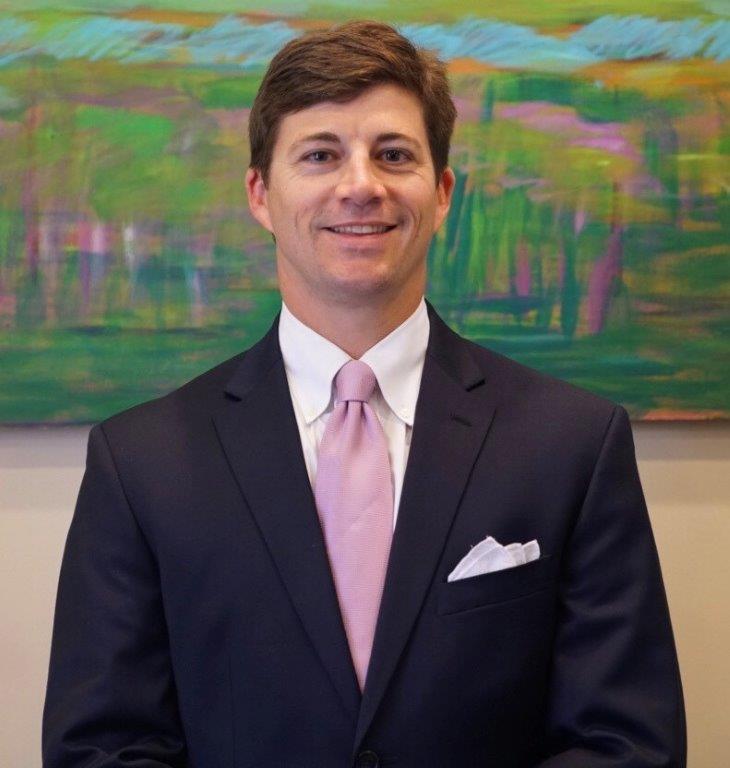 Dr. John Guste