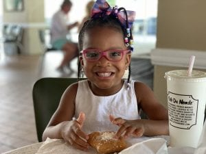 Toddler girl with pink glasses
