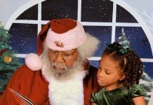 New Orleans Mom Little girl with santa claus chocolate Santa