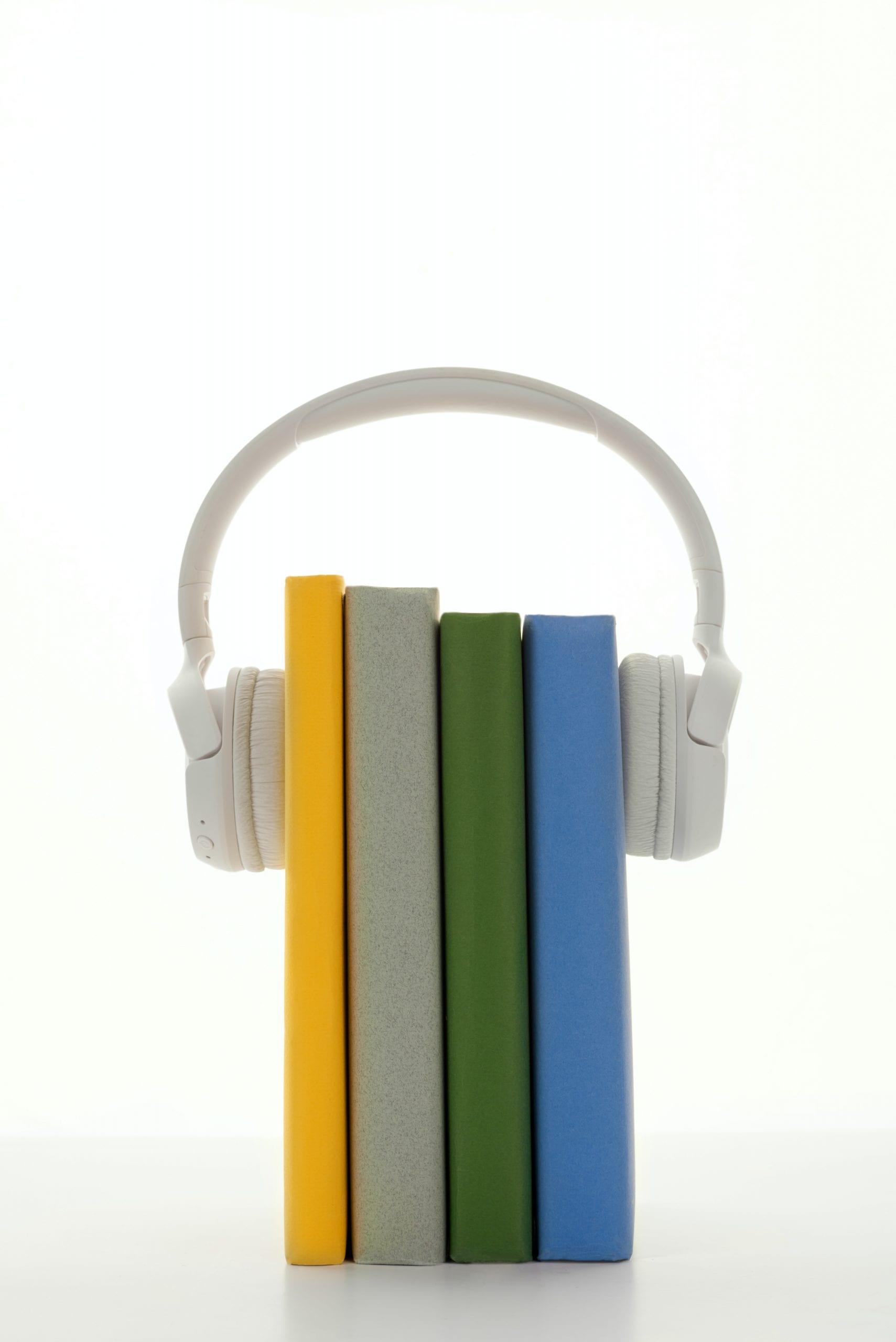 headphones on top of books