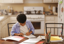 black student learning at home
