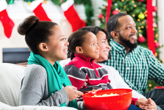 African American Family watching holiday movies