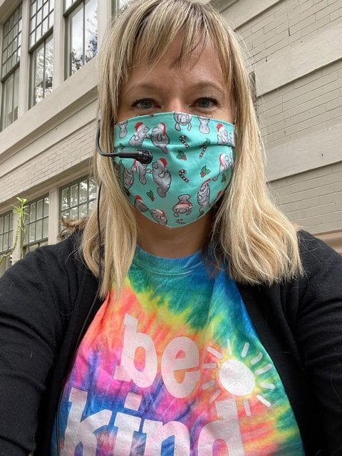 teacher wearing mask and tie dyed shirt