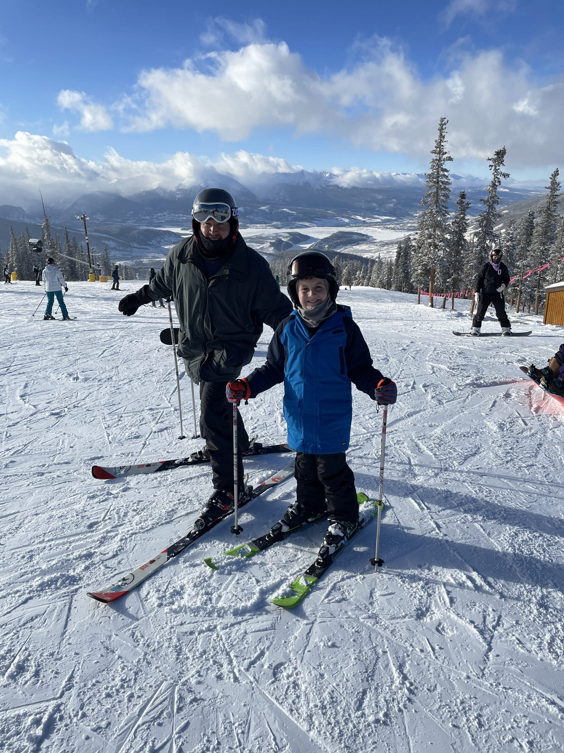 father and son on skis in Colorado
