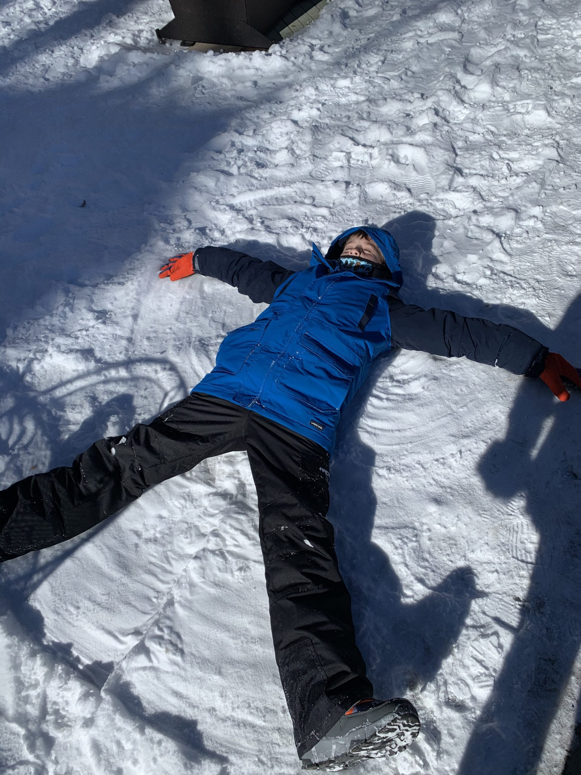 child making snow angels