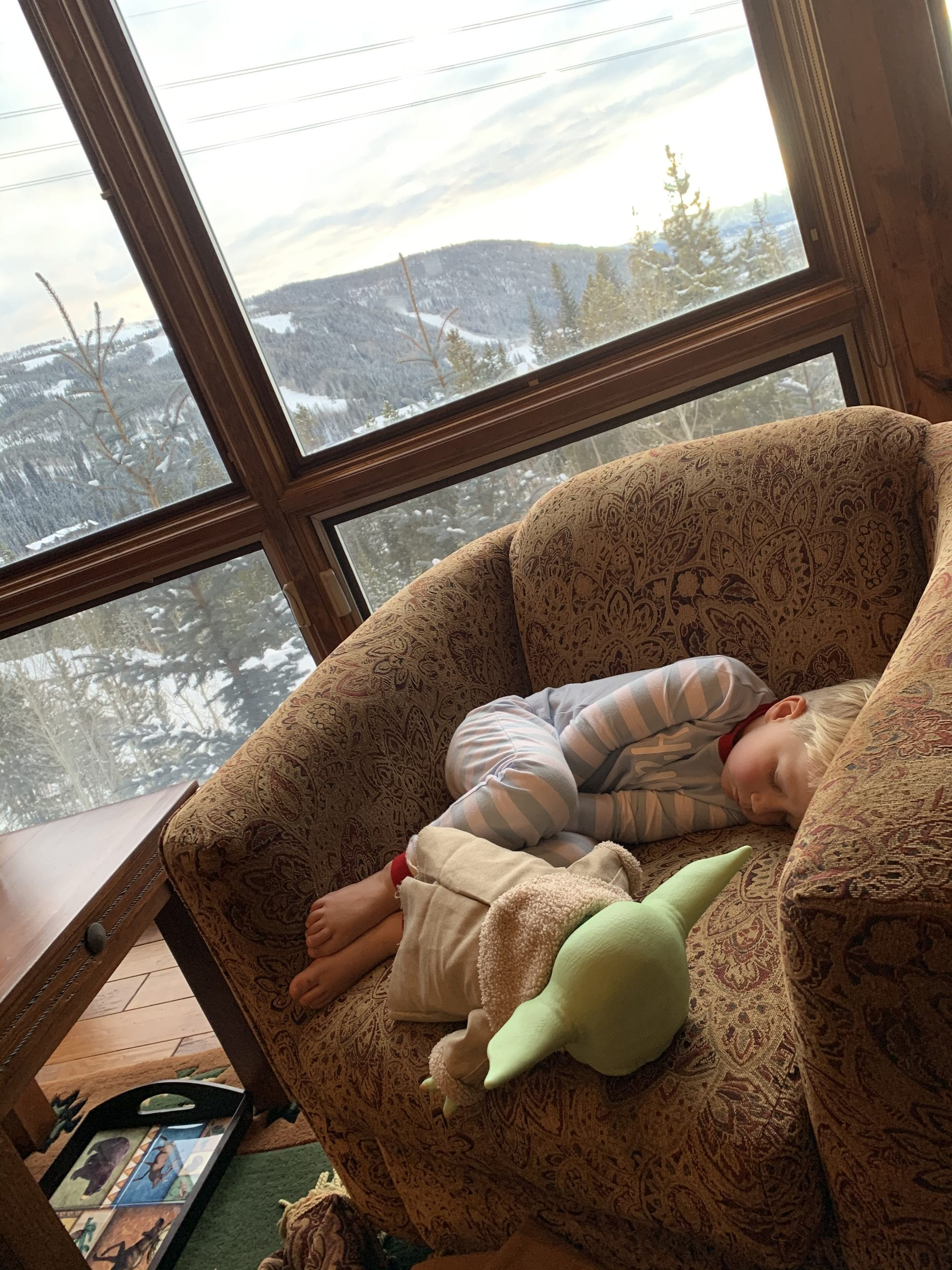child taking nap in resort in Colorado